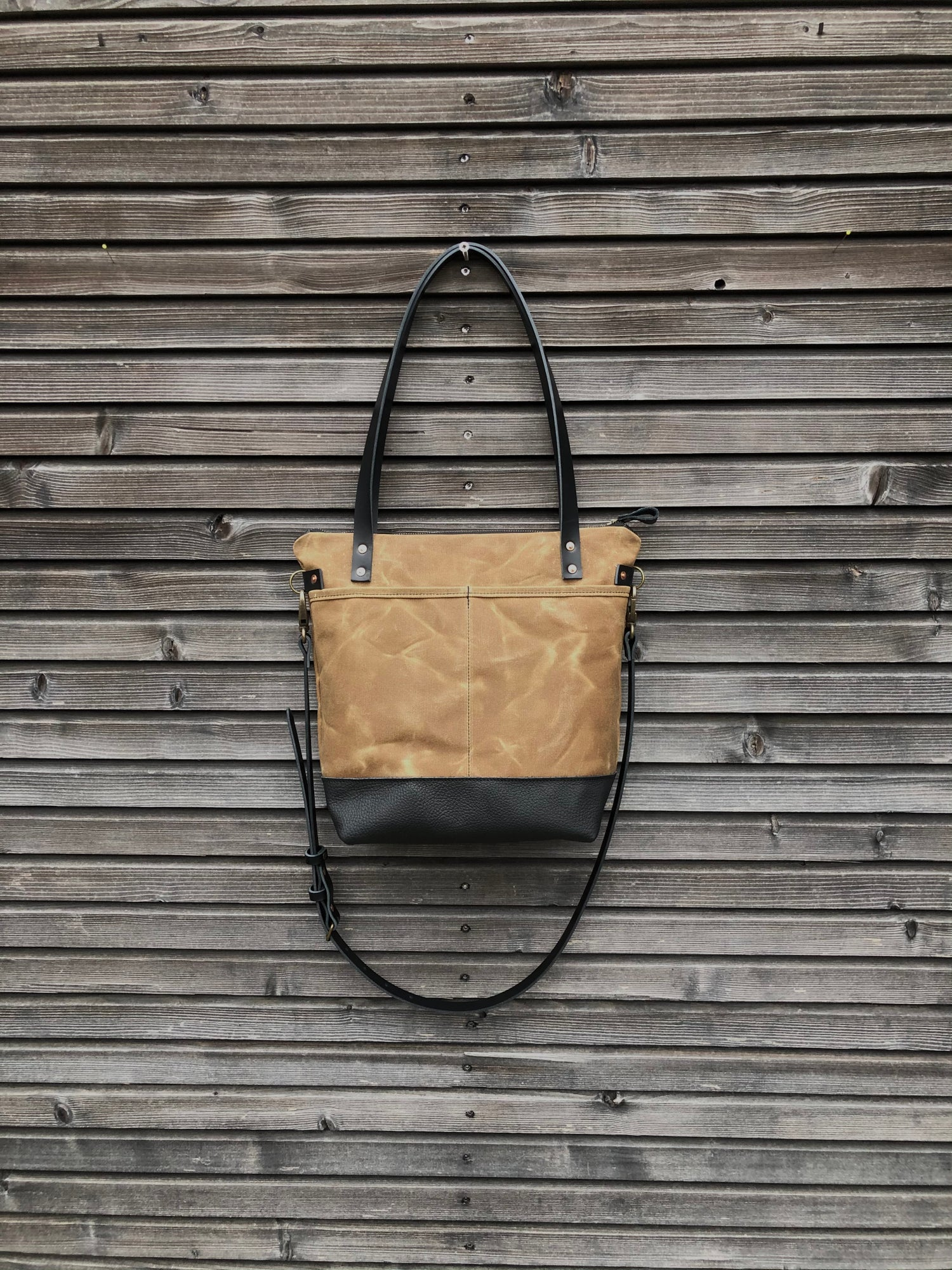 Image of Waxed canvas tote bag in spice with zipper closure and cross body strap