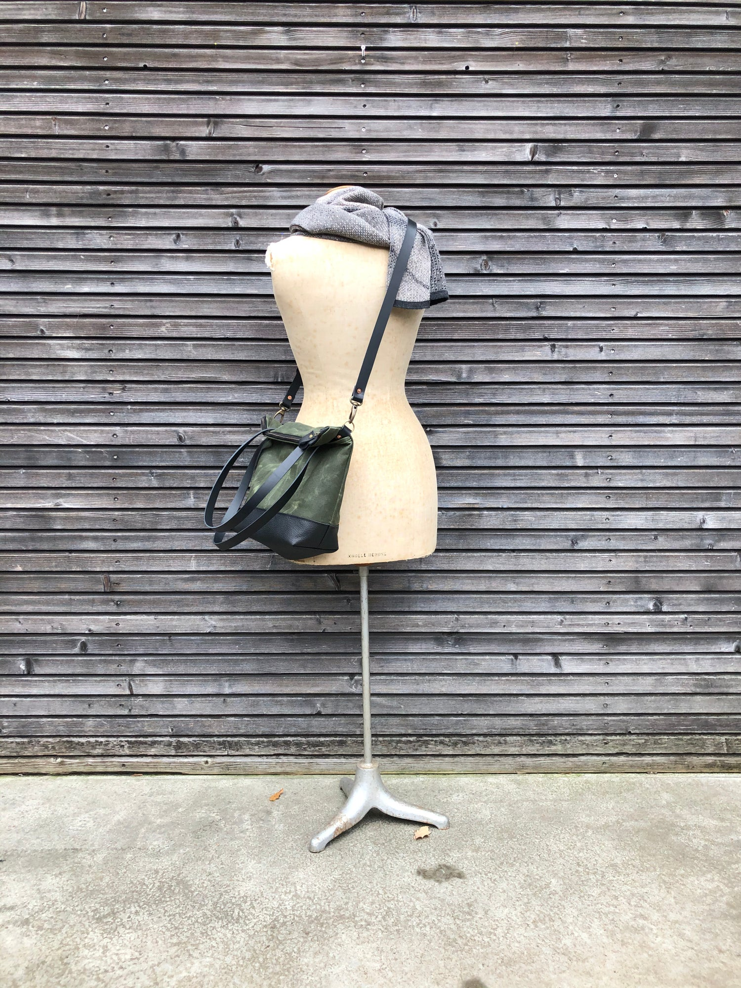 Image of Waxed canvas leather tote bag in olive green with zipper closure and cross body strap