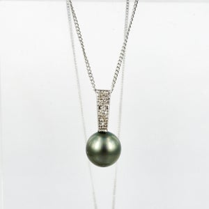 Image of Stunning 18ct white gold Tahitian pearl and pave set diamond pendant. NL13