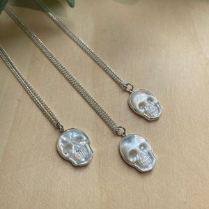Image of Hand Carved Mother of Pearl Skull 925 Sterling Silver Pendant Necklace
