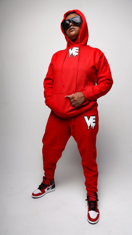 "Image of Red Unisex ""In The Middle"" Drip Patch Sweatsuit"