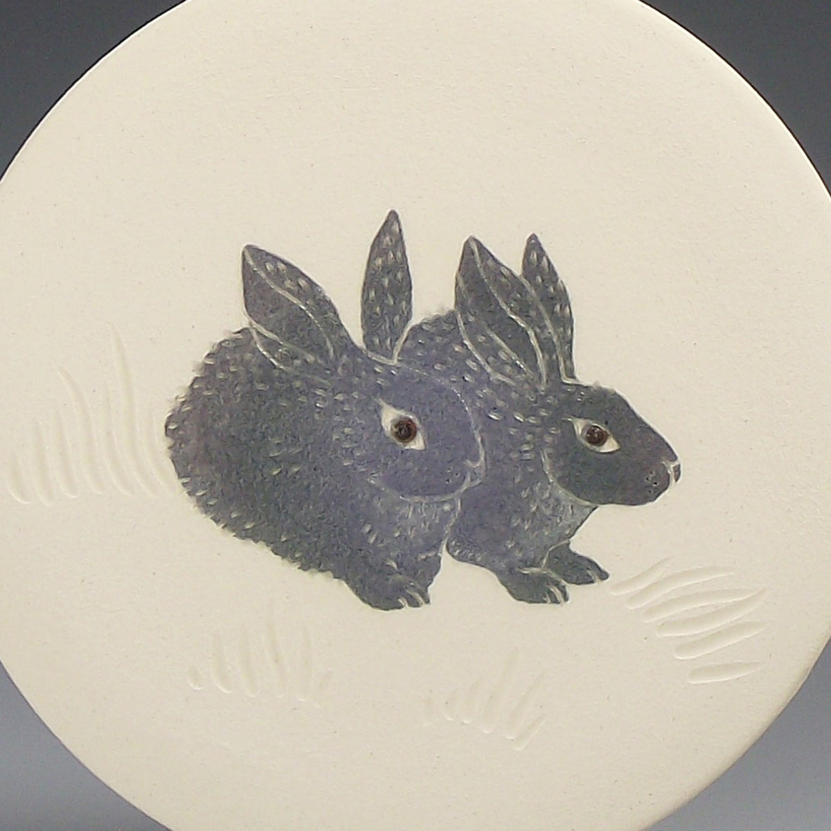 Woodland bunnies' ceramic wall hanging