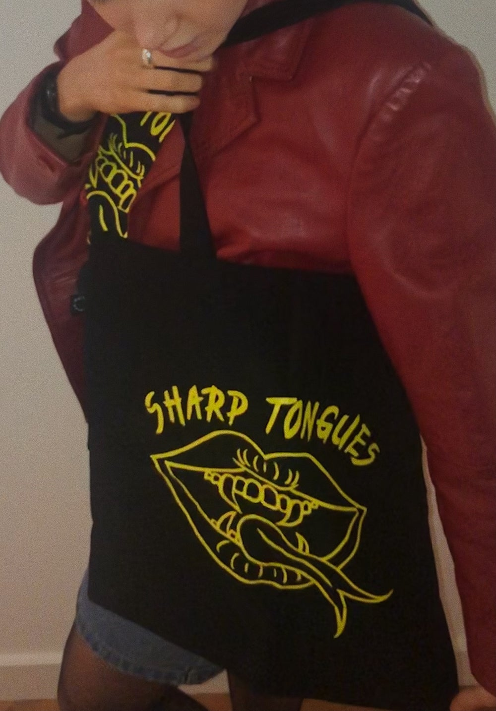 Image of Sharp Tongues Yellow on Black tote bag