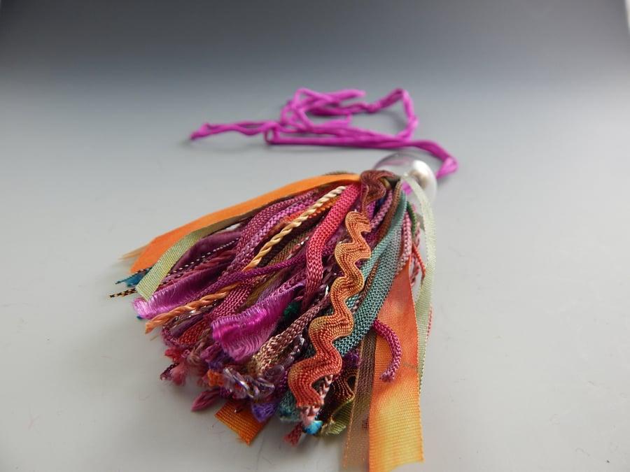 Image of Artisan Glass • Mixed Fiber Tassel in Orange & Pink