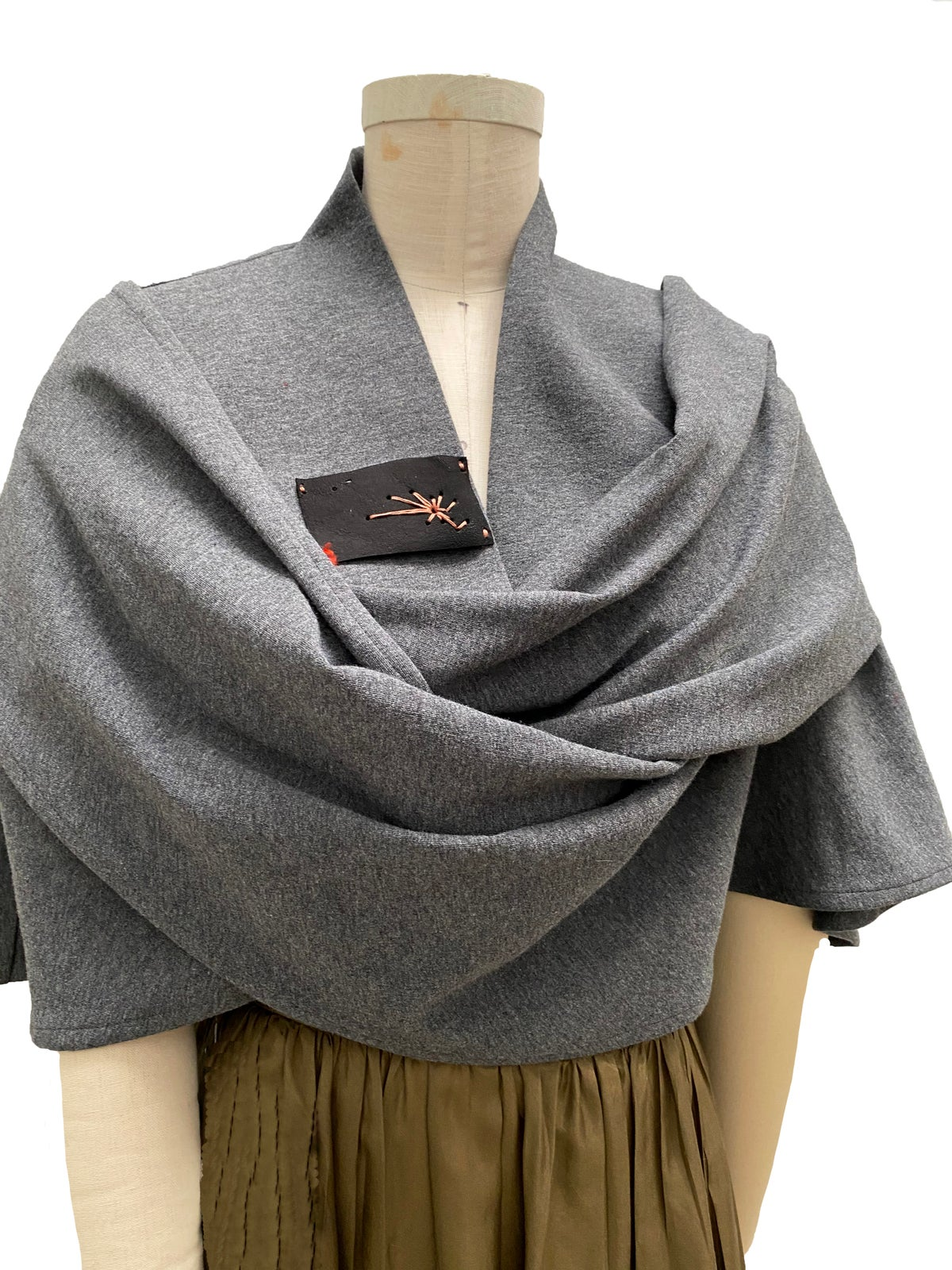 Image of wrap in gray with black square with kussharo sunset