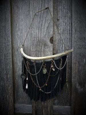 Image of Deer Rib with Leather Fringe, Chains, and trinkets