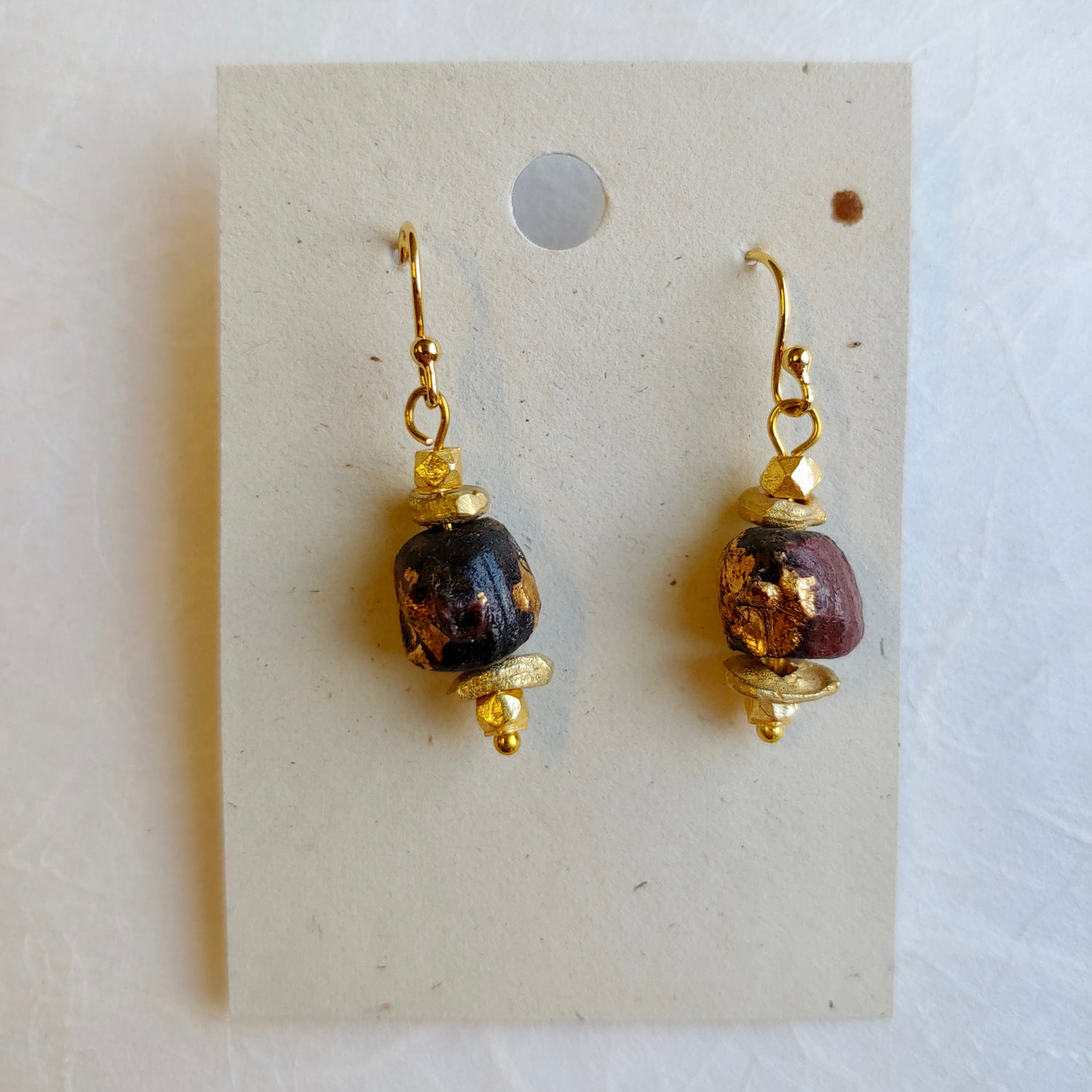 Image of Buddha and gold plated earrings