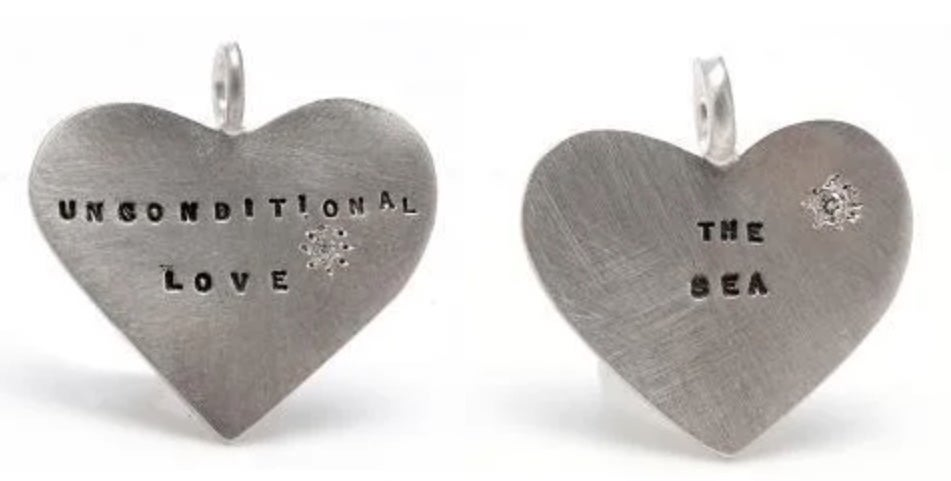 Image of Silver charms with a diamond (Well-Being, Unconditional Love, The Answer, The Sea, A Magic Wand)