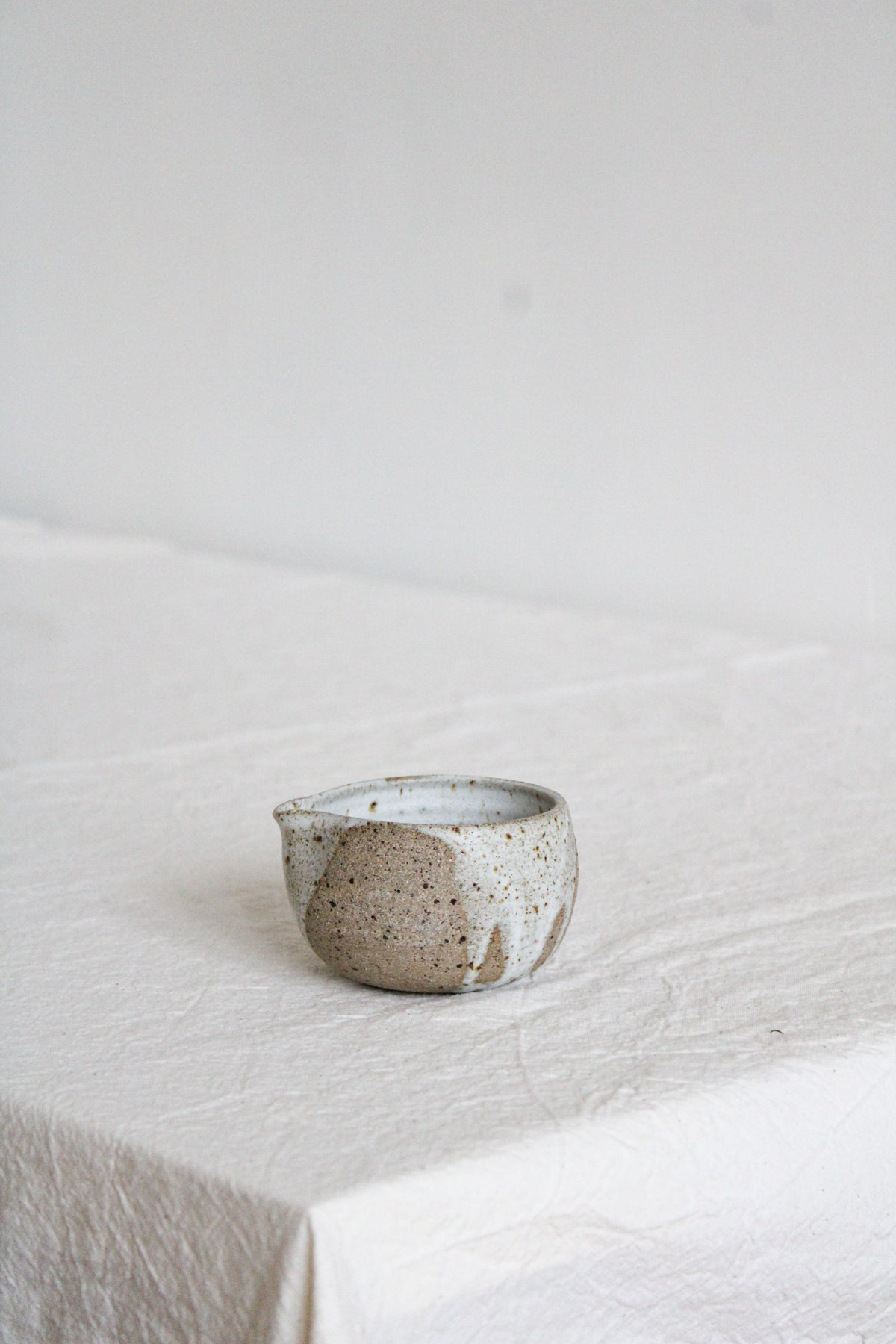 Image of pouring jug - white glaze drips