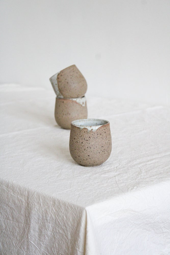 Image of small cups - white glaze drips