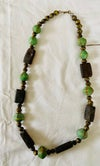 Green clay, brown stone and brass bead necklace