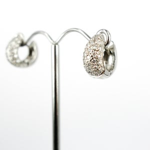 Image of Elegant 18ct white gold pave set huggie earrings. Pj4906