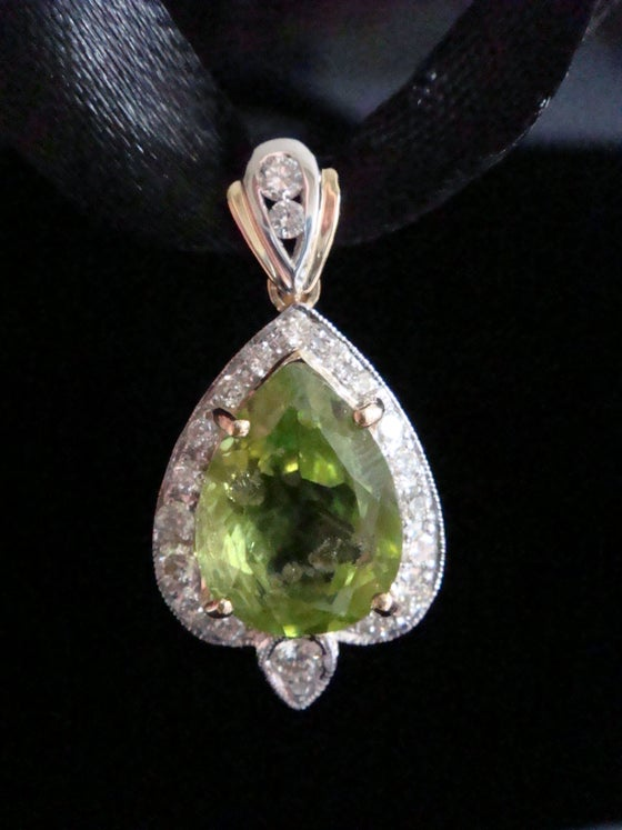 Image of 18ct yellow gold natural peridot 5.27ct and diamond 0.52ct cluster pendant