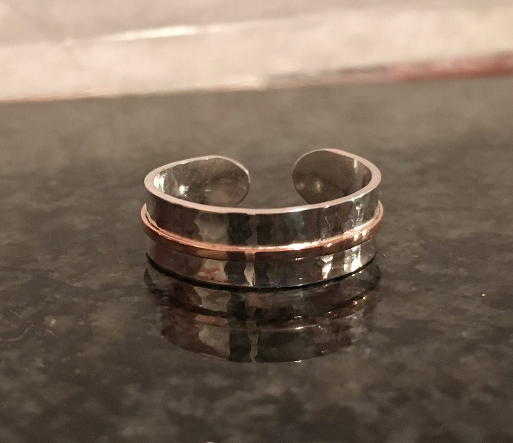 Image of Hammered silver and red 9ct gold ring