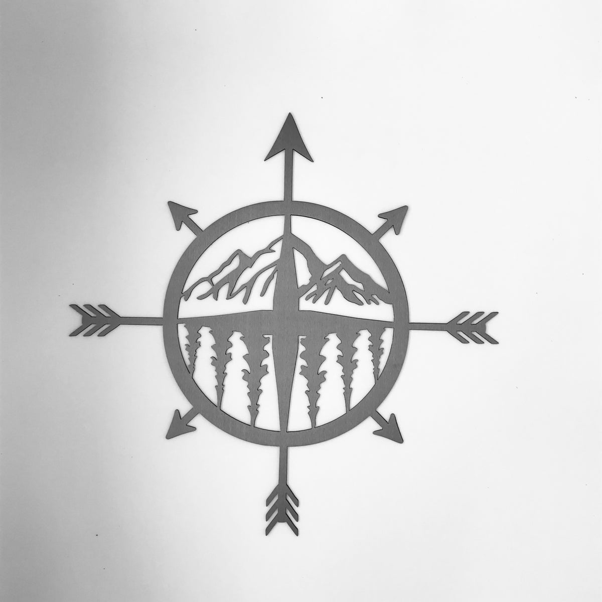 Compass with Mountain Scene