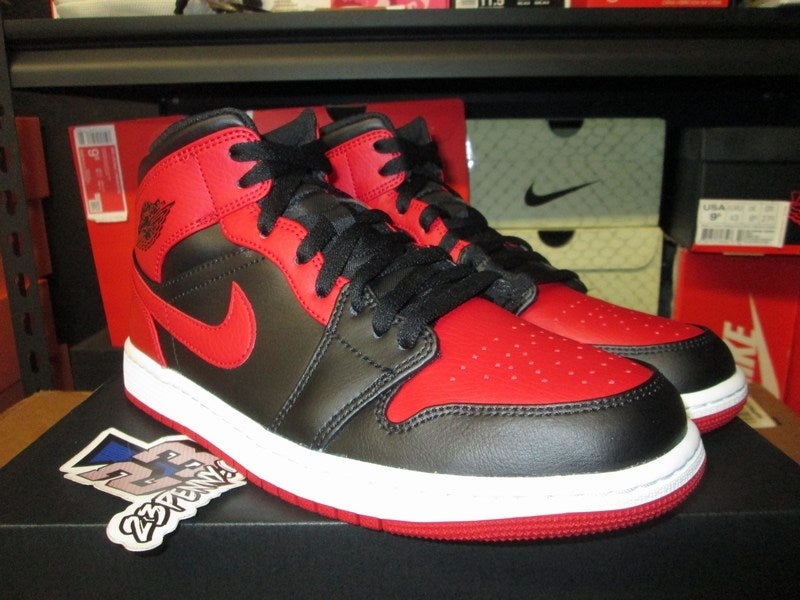 "Image of Air Jordan I (1) Retro Mid ""Banned"""
