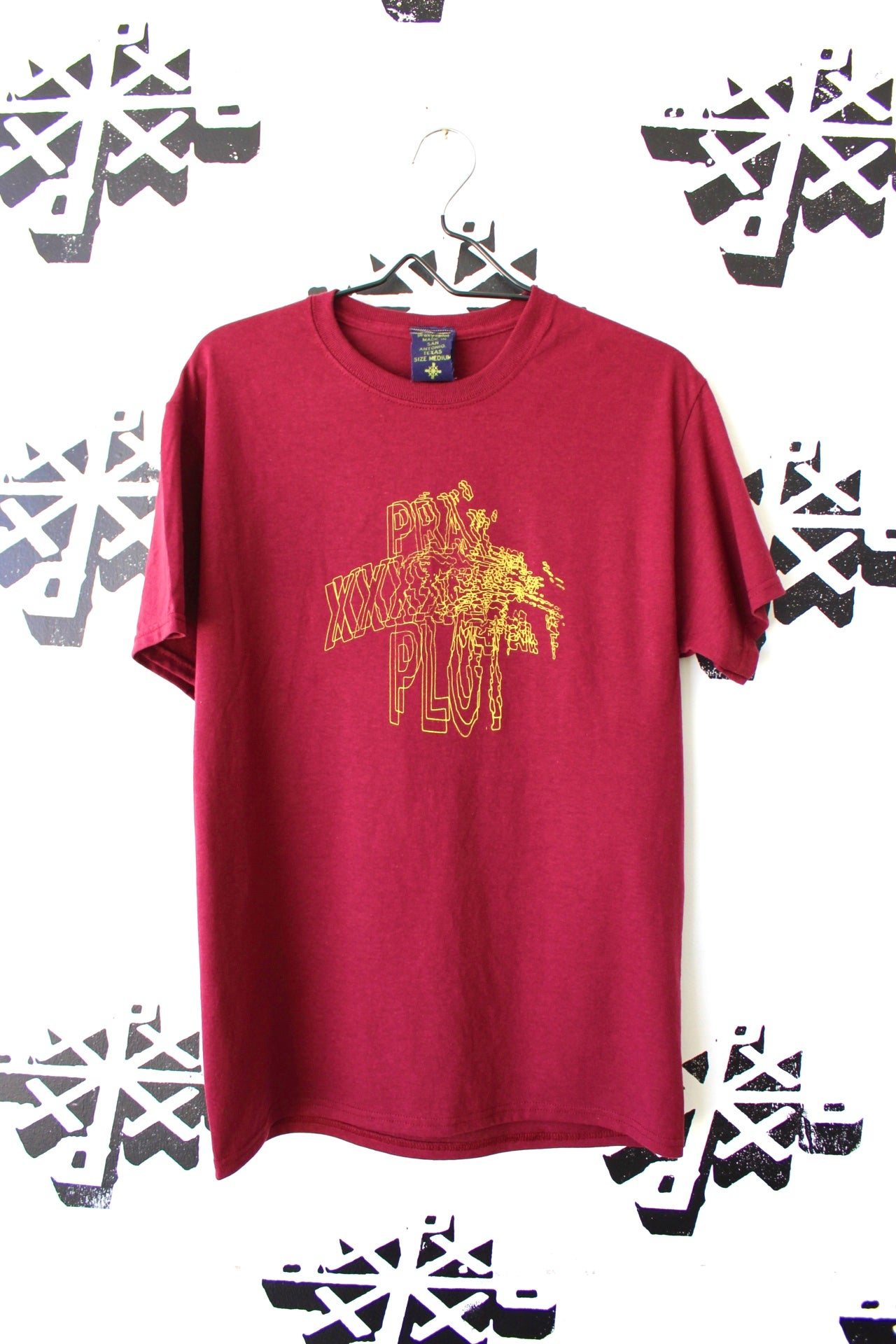 Image of gotta blast tee in maroon