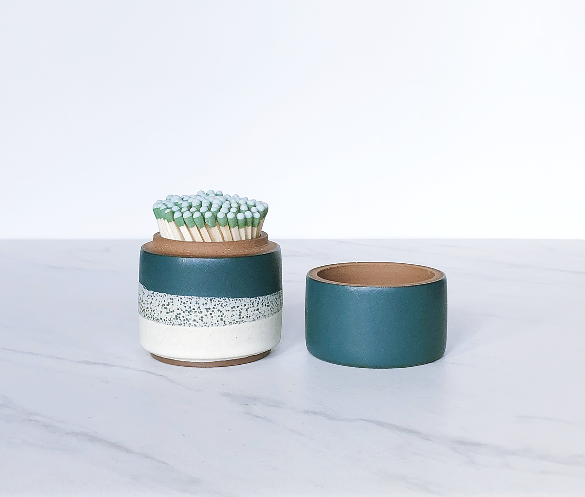 Image of Ceramic match holder with lid, glazed in matte teal + cream