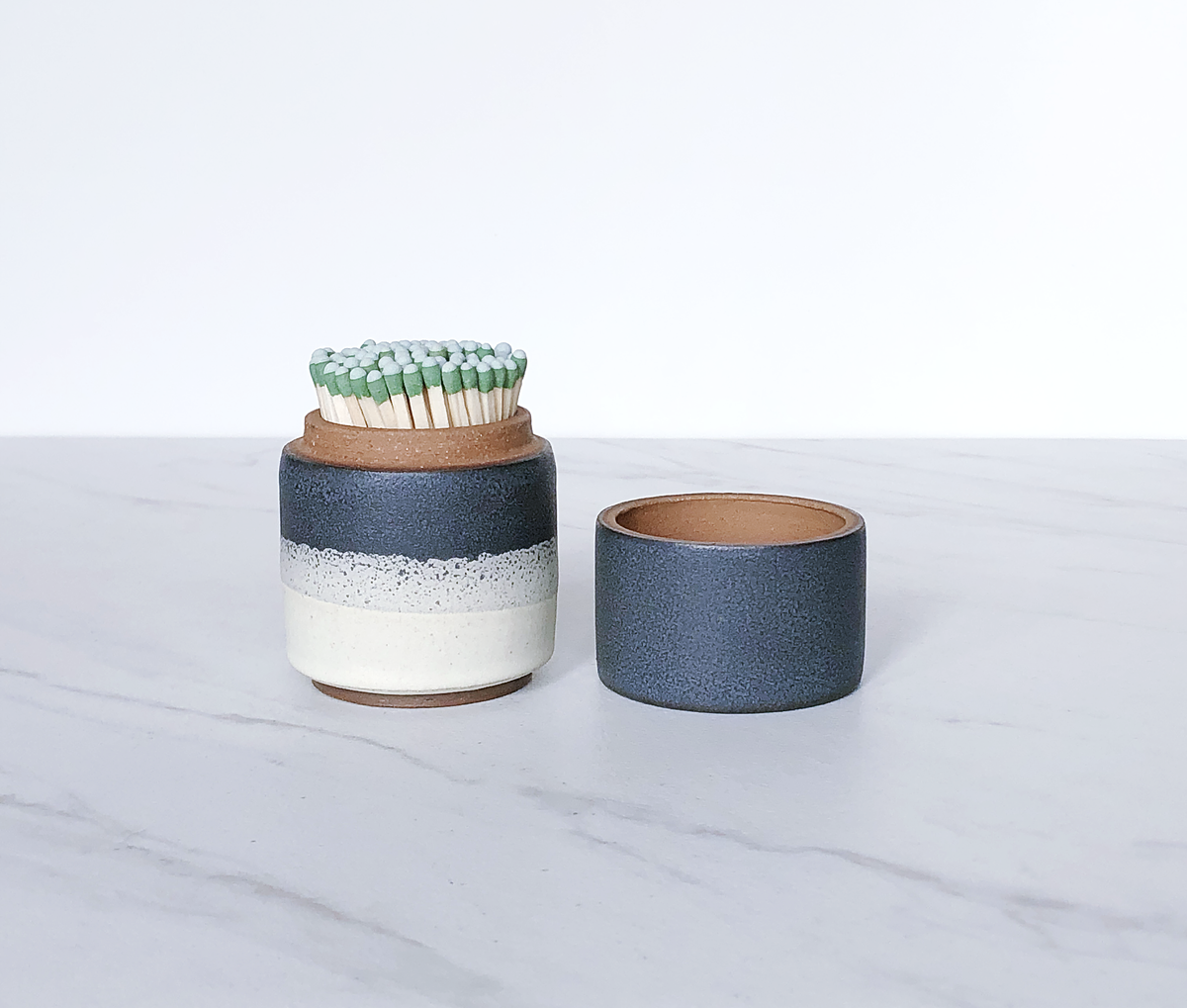 Image of Ceramic match holder with lid, glazed in matte navy + cream