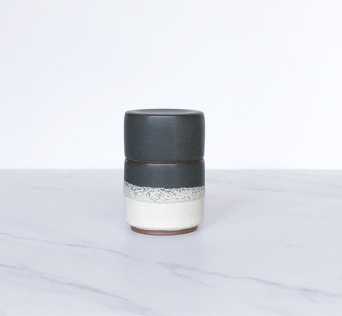 Image of Ceramic match holder with lid, glazed in matte charcoal + cream