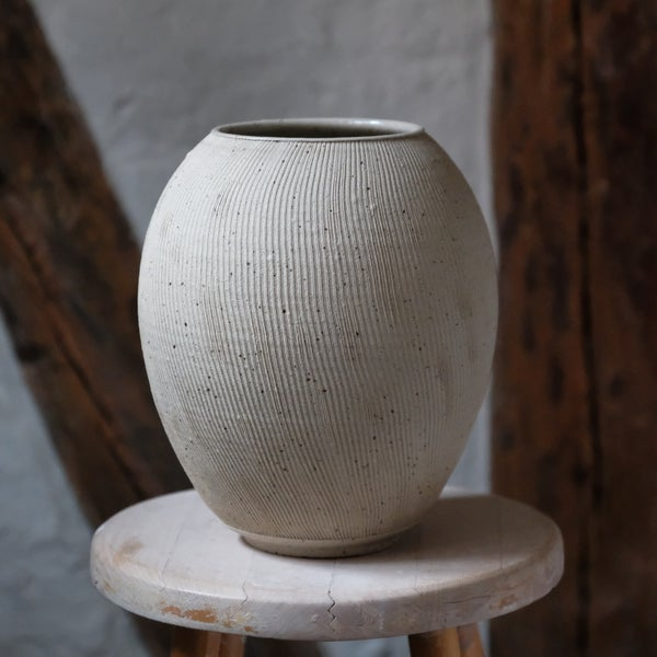 Image of  FLUTED UNIKA VASE IN SPECKLED STONEWARE, GLAZED INTERIOR, RAW EXTERIOR