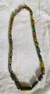 necklace of old millefiore trade beads separated by small black beads