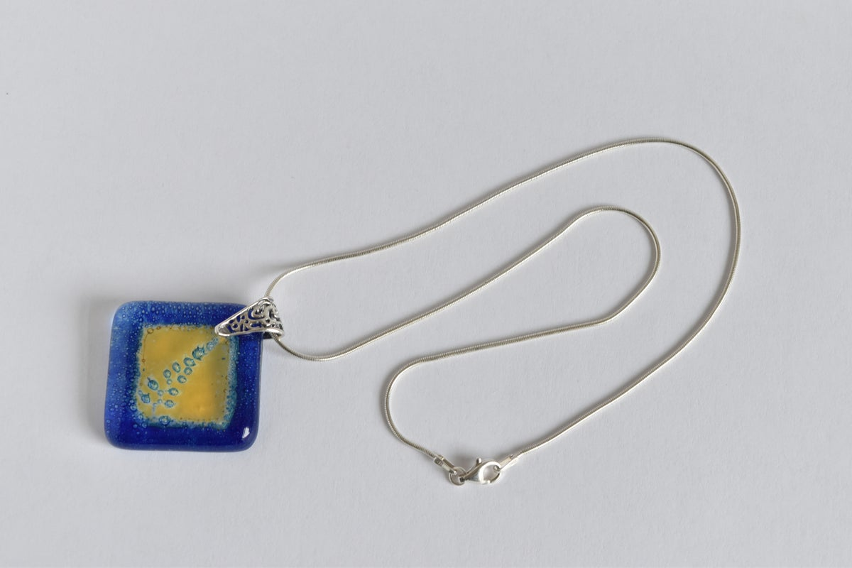 Image of Holly Fern Golden Window Cobalt Blue Pendant Necklace
