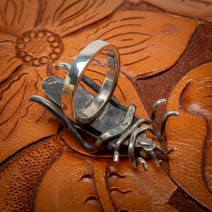 Image of Vintage Navajo Sterling Silver and Turquoise Cricket Ring   Size 6.75 made by Tim Yazzie
