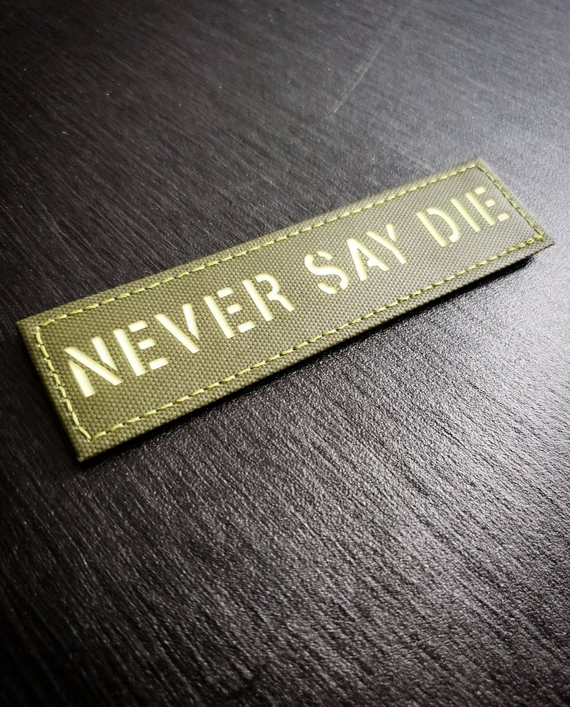 Image of Never Say Die laser cut gitd patch (Green)