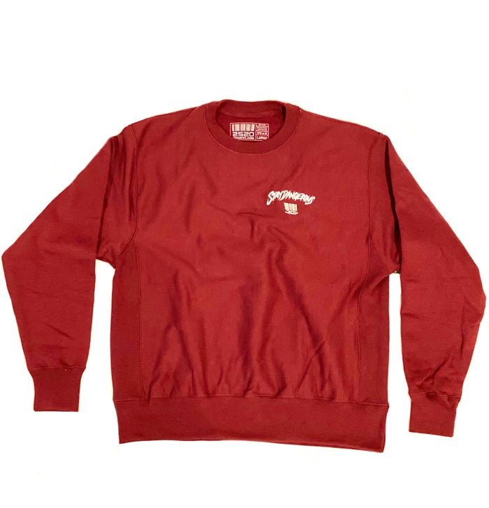 "Image of 2520 X CHAMPION ""STAY DANGEROUS"" SWEATSHIRT - CARDINAL"