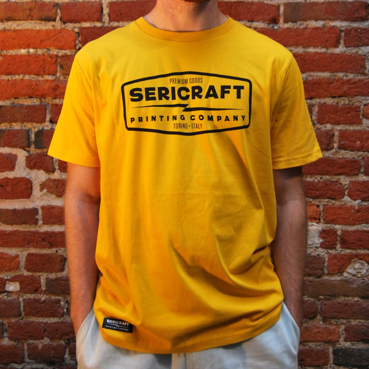 Image of SERICRAFT EMBLEM TEE - YELLOW