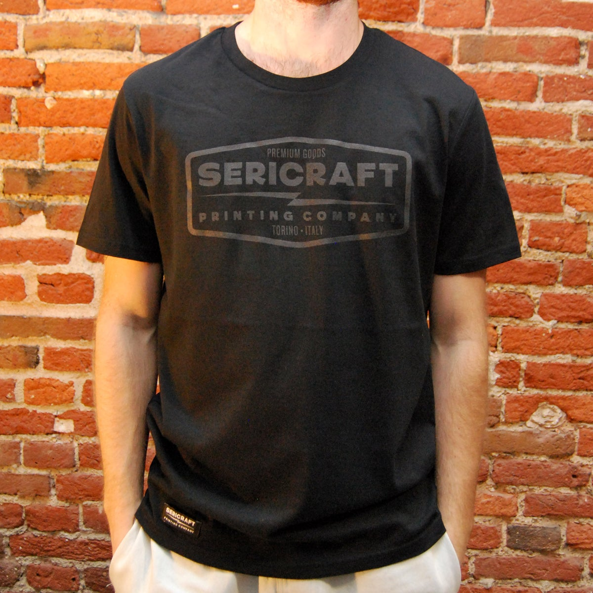 Image of SERICRAFT EMBLEM TEE - BLACK