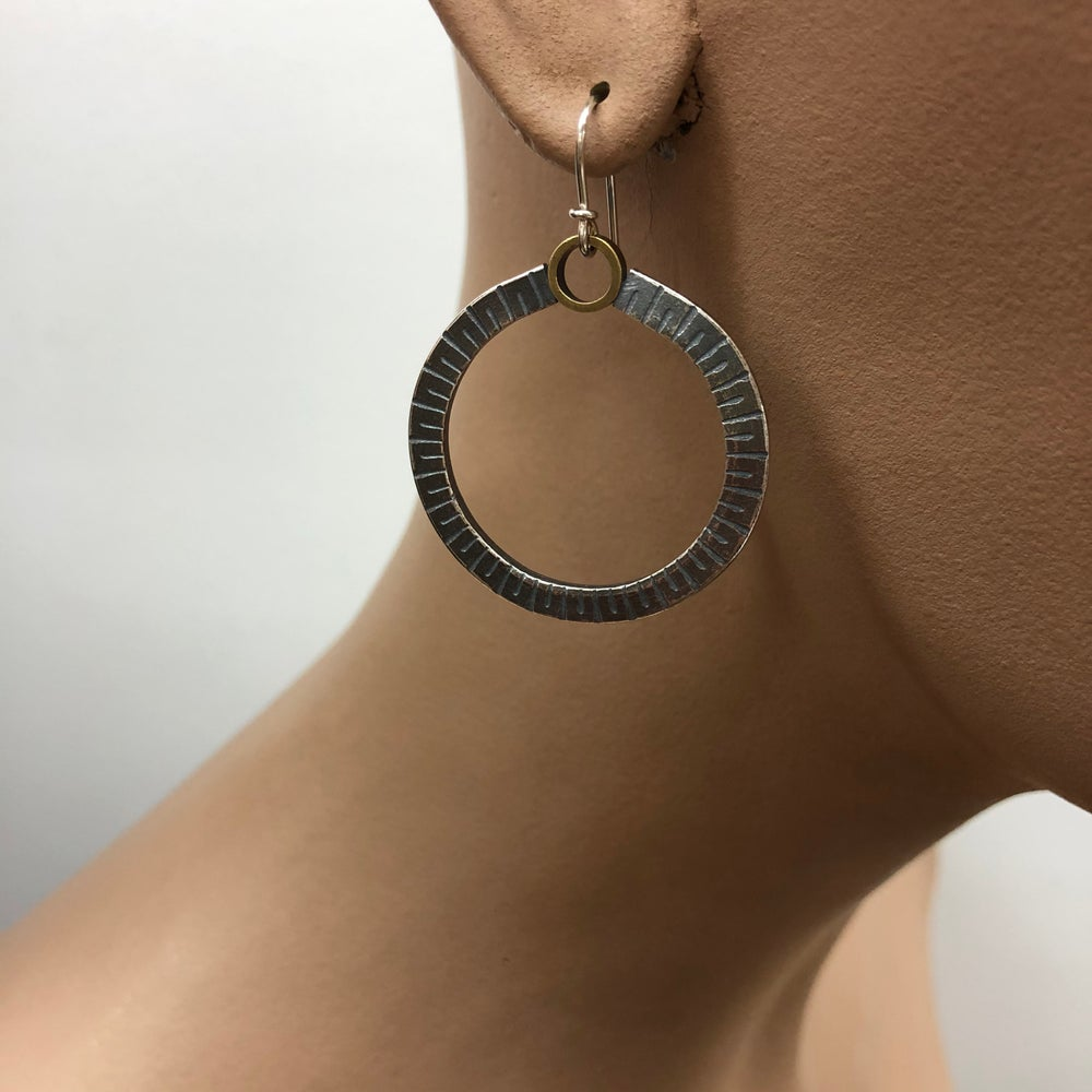 Image of round rule earrings