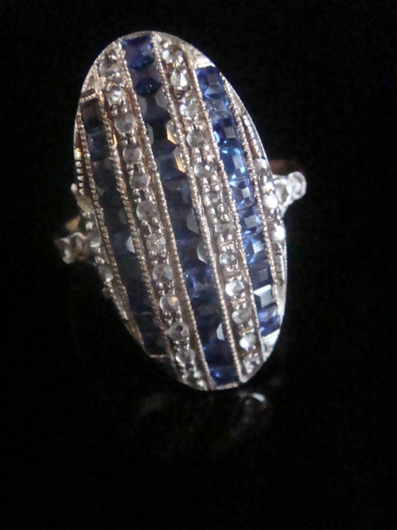 Image of Edwardian 18ct yellow gold platinum calibre cut sapphire and diamond panel ring