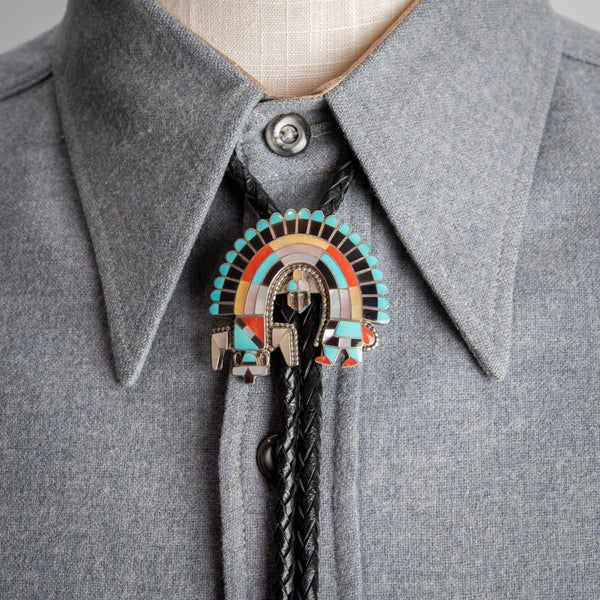 Image of Vintage 1984 Rainbow-man Bolo Tie  by Zuni Silversmith Fadrian Bowannie.
