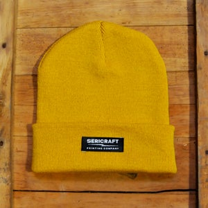 Image of SERICRAFT EMBLEM BEANIE - YELLOW