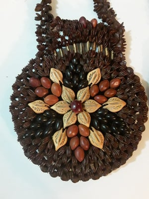 Image of Pocketbook made from beans and seeds