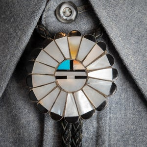 Image of Mother of Pearl Zuni Sun Face Bolo Tie signed by Zuni Silversmith TYC Inlay over Sterling Silver