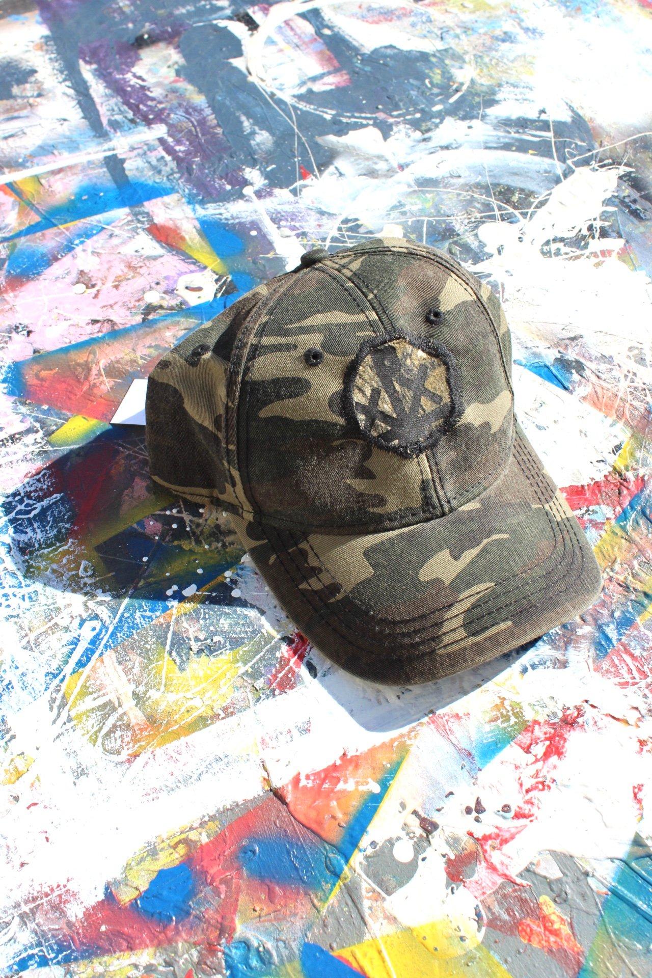 Image of center piece cap in camo