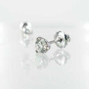 Image of 14K white gold 2 = .64ct Diamond stud earrings. Pj5750