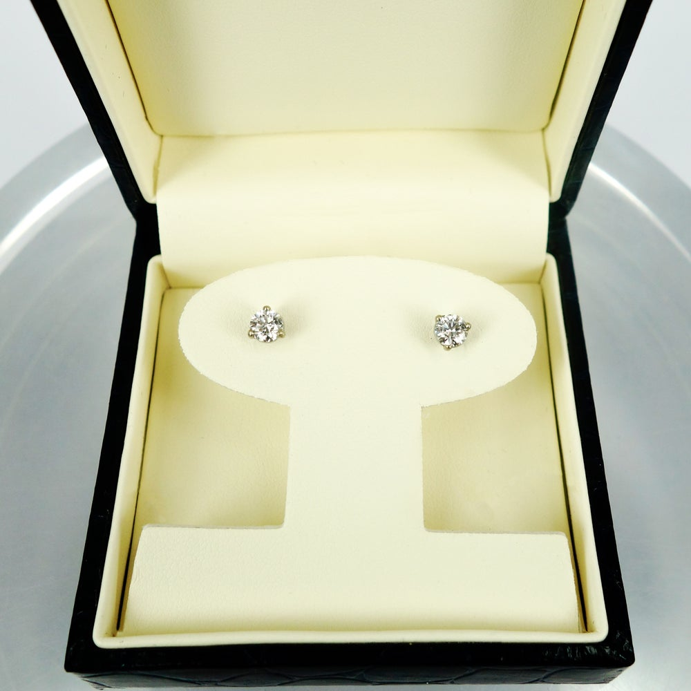Image of 14K white gold 2 = .64ct Diamond stud earrings. Pj5750