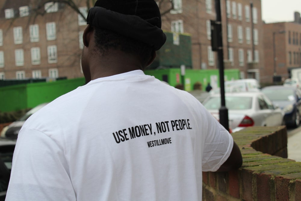 "Image of ""USE MONEY, NOT PEOPLE."" WHITE OVERSIZED T SHIRT"