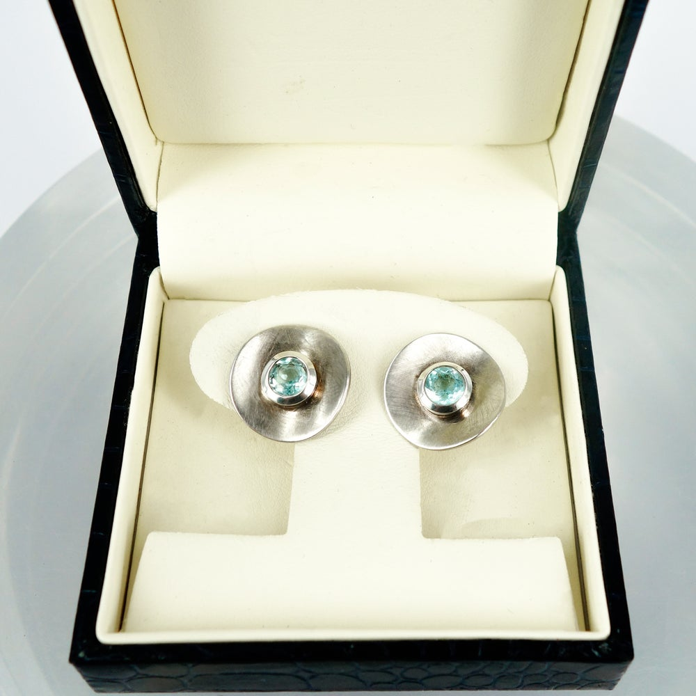 Image of Large sterling silver and blue topaz disc earrings. S/S1