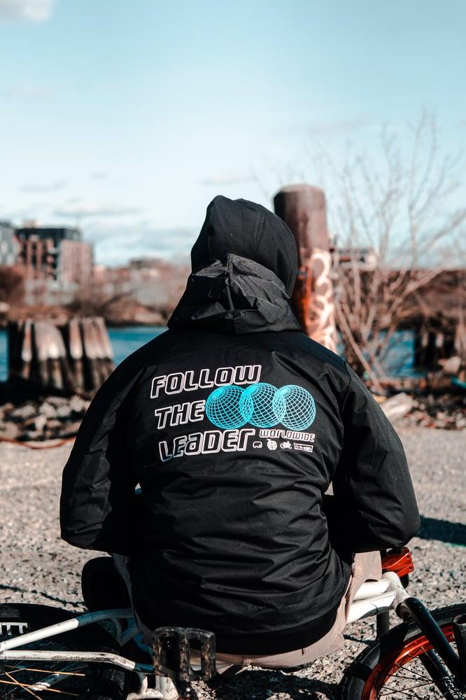 Image of Tri World Hooded Coach Jacket