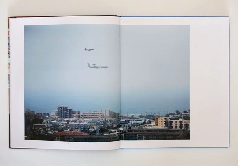 "Image of Hotel Okinawa. In hardened slipcase with signed 8x10 inch print (""Mount Blanc Hotel, Okinawa City"")."