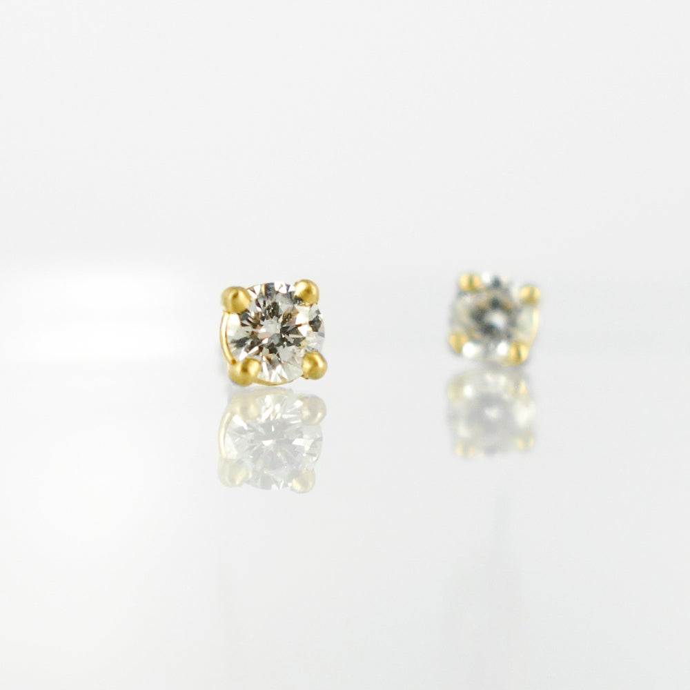 Image of 18ct yellow gold four claw diamond stud earrings. SH