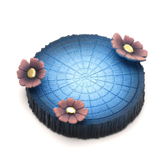 Image of Chikkoi Warrior tree ring base with flowers