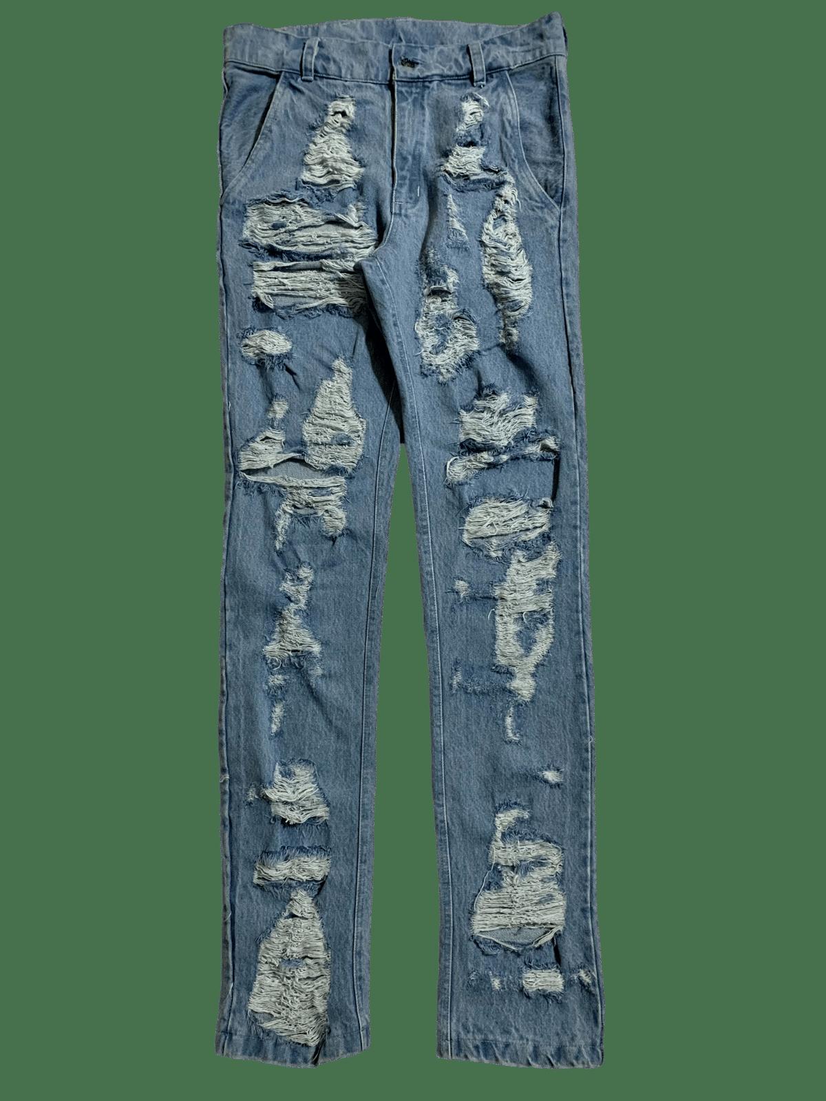 Image of DESTROYED DISTRESSED LIGHT BLUE DENIM SKINNY JEANS
