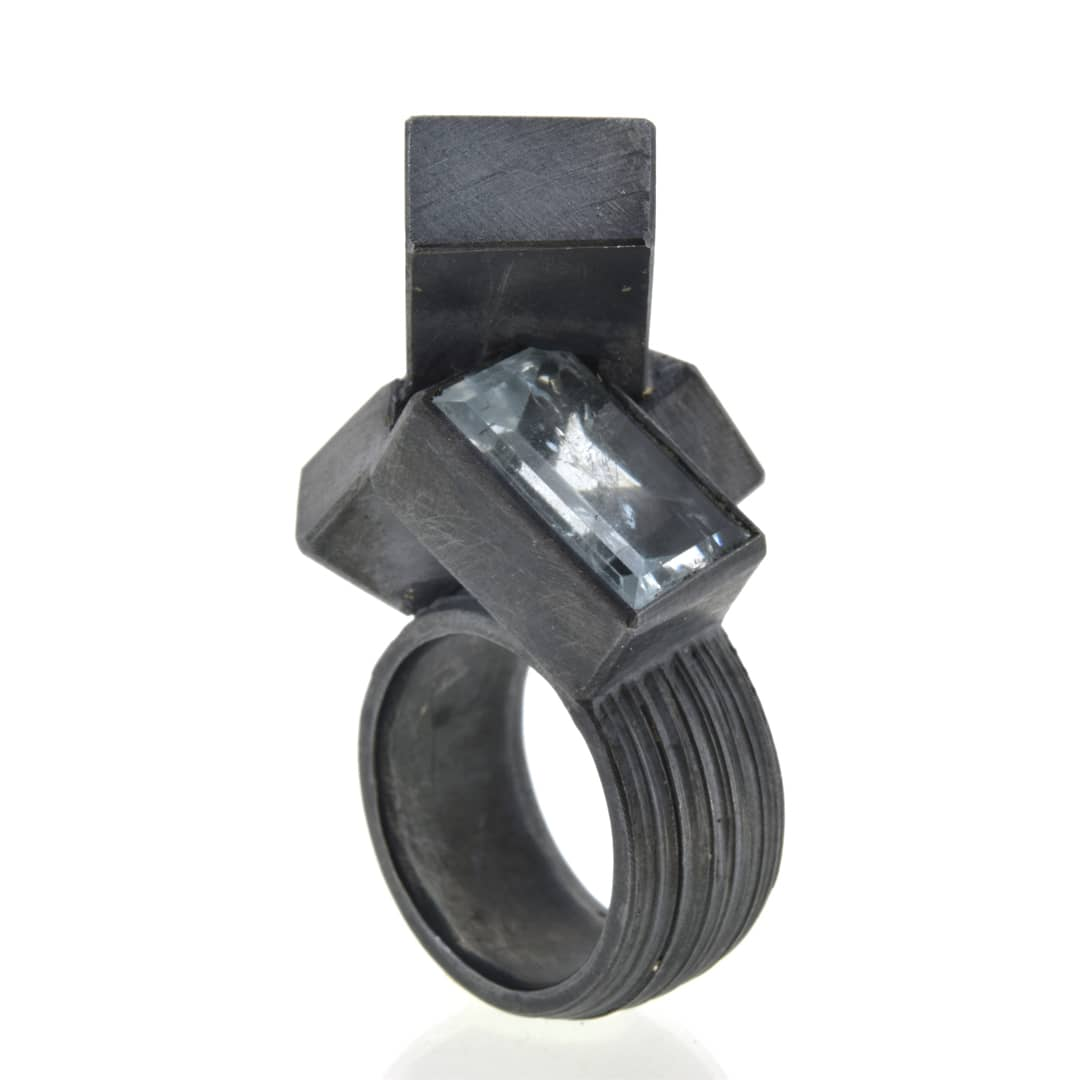 Contemporary sculptural oxidised silver ring set with aquamarine. Chris Boland Jewellery