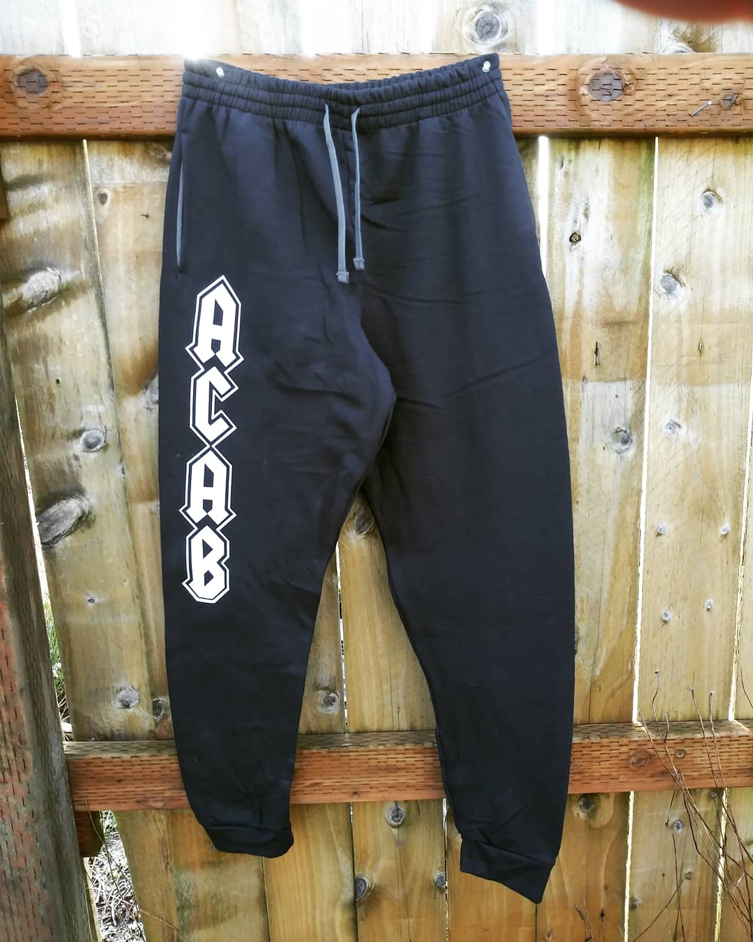 Image of ACAB Joggers in Heavy Metal Font with POCKETS